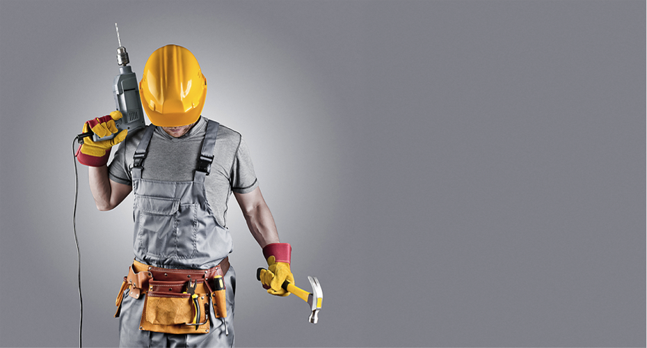Tradesman holding a drill and a hammer